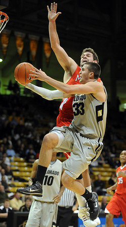 """Austin Dufault of CU tries to score past Adam Fletcher of Miami of Ohio.<br /> For more photos of the game, go to  <a href=""""http://www.dailycamera.com"""">http://www.dailycamera.com</a>.<br /> Cliff Grassmick / January 5, 2010"""
