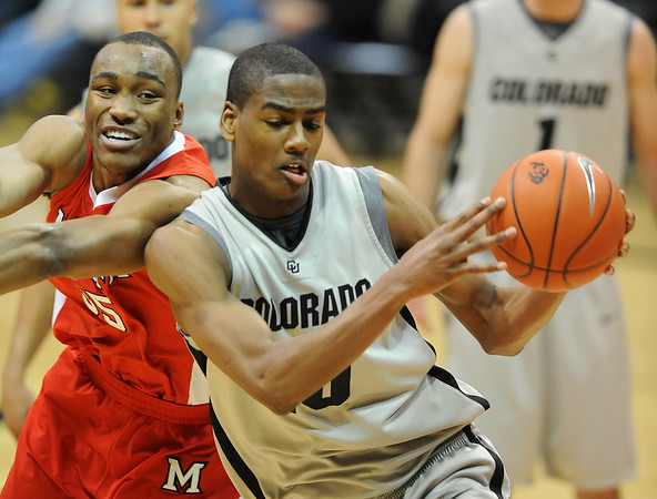 "Antonio Ballard, left, of Miami of Ohio, tries to put the breaks on Alec Burks of Colorado.<br /> For more photos of the game, go to  <a href=""http://www.dailycamera.com"">http://www.dailycamera.com</a>.<br /> Cliff Grassmick / January 5, 2010"