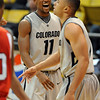 "Cory Higgins of CU is happy about the basket made  and foul on Marcus Relphorde.<br /> For more photos of the game, go to  <a href=""http://www.dailycamera.com"">http://www.dailycamera.com</a>.<br /> Cliff Grassmick / January 5, 2010"