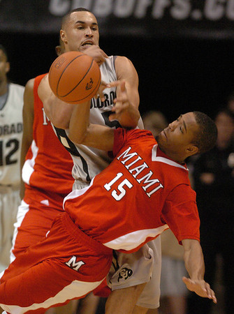 """Marcus Relphorde, top, of CU tries to rip the ball from Orlando Williams of Miami of Ohio.<br /> For more photos of the game, go to  <a href=""""http://www.dailycamera.com"""">http://www.dailycamera.com</a>.<br /> Cliff Grassmick / January 5, 2010"""