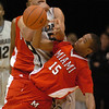 "Marcus Relphorde, top, of CU tries to rip the ball from Orlando Williams of Miami of Ohio.<br /> For more photos of the game, go to  <a href=""http://www.dailycamera.com"">http://www.dailycamera.com</a>.<br /> Cliff Grassmick / January 5, 2010"