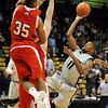 "Cory Higgins  of CU hangs in the air to put this shot up against Miami of Ohio.<br /> For more photos of the game, go to  <a href=""http://www.dailycamera.com"">http://www.dailycamera.com</a>.<br /> Cliff Grassmick / January 5, 2010"