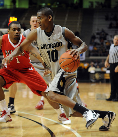 "Alec Burks of CU drives around Rodney Haddix of Miami of Ohio.<br /> For more photos of the game, go to  <a href=""http://www.dailycamera.com"">http://www.dailycamera.com</a>.<br /> Cliff Grassmick / January 5, 2010"