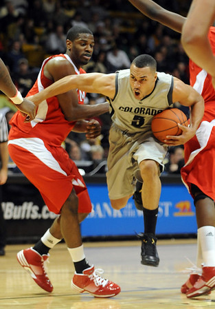 "Marcus Relphorde of CU, makes like a fullback to get through Nick Winbush of Miami of Ohio.<br /> For more photos of the game, go to  <a href=""http://www.dailycamera.com"">http://www.dailycamera.com</a>.<br /> Cliff Grassmick / January 5, 2010"