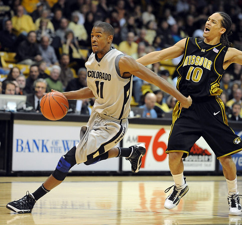 Cory Higgins of Colorado drives past Mike Dixon of Missouri on Saturday.<br /> Cliff Grassmick / February 6, 2010