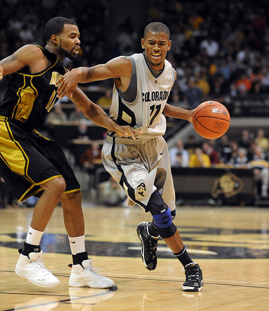 Cory Higgins of Colorado gets around Zaire Taylor of Missouri.<br /> Cliff Grassmick / February 6, 2010