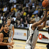 Alec Burks gets past Justin Safford of Missouri.<br /> Cliff Grassmick / February 6, 2010