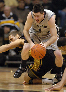 Nate Tomlinson gets a steal from Justin Stafford of Missouri. Cliff Grassmick / February 6, 2010