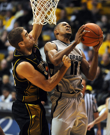 Cory Higgins goes up strong against Justin Safford of Missouri on Saturday.<br /> Cliff Grassmick / February 6, 2010