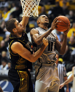 Cory Higgins goes up strong against Justin Safford of Missouri on Saturday. Cliff Grassmick / February 6, 2010