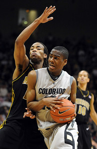 Alec Burks of Colorado drives into Marcus Denmon of Missouri during the first half of the February 6, 2010 game in Boulder. Cliff Grassmick / February 6, 2010