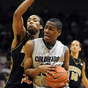 Alec Burks of Colorado drives into Marcus Denmon of Missouri during the first half of the February 6, 2010 game in Boulder.<br /> Cliff Grassmick / February 6, 2010