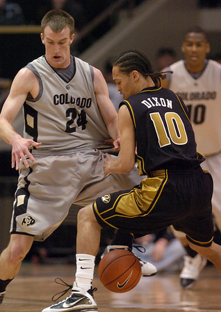 Levi Knutson of CU stops Mike Dixon of MU on Saturday.<br /> Cliff Grassmick / February 6, 2010