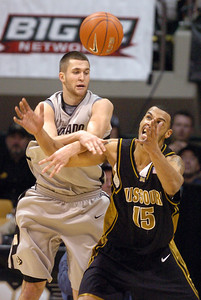 Austin Dufault, left, of Colorado, knocks the ball away from Keith Ramsey of Missouri during the first half of the February 6, 2010 game in Boulder. Cliff Grassmick / February 6, 2010