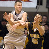 Austin Dufault, left, of Colorado, knocks the ball away from Keith Ramsey of Missouri during the first half of the February 6, 2010 game in Boulder.<br /> Cliff Grassmick / February 6, 2010