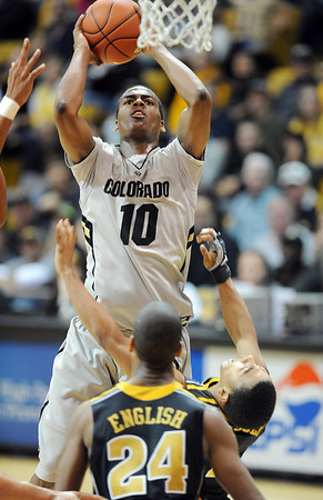 """Alec Burks of CU goes into score against Missouri on Saturday.<br /> For more photos of the game, go to  <a href=""""http://www.dailycamera.com"""">http://www.dailycamera.com</a>.<br /> Cliff Grassmick / January 8, 2011"""