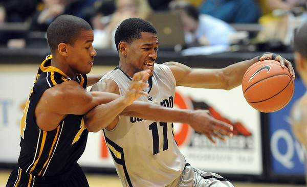 """Cory Higgins of CU battle with Kim English of Missouri.<br /> For more photos of the game, go to  <a href=""""http://www.dailycamera.com"""">http://www.dailycamera.com</a>.<br /> Cliff Grassmick / January 8, 2011"""