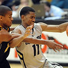 "Cory Higgins of CU battle with Kim English of Missouri.<br /> For more photos of the game, go to  <a href=""http://www.dailycamera.com"">http://www.dailycamera.com</a>.<br /> Cliff Grassmick / January 8, 2011"