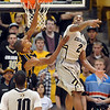 "Shannon Sharpe of CU blocks the shot of Kim English of Missouri.<br /> For more photos of the game, go to  <a href=""http://www.dailycamera.com"">http://www.dailycamera.com</a>.<br /> Cliff Grassmick / January 8, 2011"
