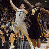 "Nate Tomlinson of CU tries to get a lay up under Ricardo Ratliffe of Missouri.<br /> For more photos of the game, go to  <a href=""http://www.dailycamera.com"">http://www.dailycamera.com</a>.<br /> Cliff Grassmick / January 8, 2011"