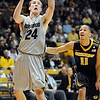 "Levi Knutson of Colorado drives around Michael Dixon of Missouri.<br /> For more photos of the game, go to  <a href=""http://www.dailycamera.com"">http://www.dailycamera.com</a>.<br /> Cliff Grassmick / January 8, 2011"