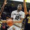 "Alec Burks of CU drive between Kim English, left, and Laurence Bowers of Missouri.<br /> For more photos of the game, go to  <a href=""http://www.dailycamera.com"">http://www.dailycamera.com</a>.<br /> Cliff Grassmick / January 8, 2011"