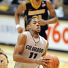 "Cory Higgins of CU drives to the basket  against Missouri.<br /> For more photos of the game, go to  <a href=""http://www.dailycamera.com"">http://www.dailycamera.com</a>.<br /> Cliff Grassmick / January 8, 2011"