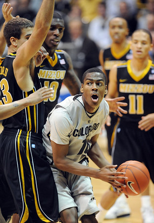 """Alec Burks of CU battles under the basket against Justin Safford, among other  Missouri players.<br /> For more photos of the game, go to  <a href=""""http://www.dailycamera.com"""">http://www.dailycamera.com</a>.<br /> Cliff Grassmick / January 8, 2011"""