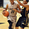 "Cory Higgins of CU drives to the basket  against Matt Pressey of  Missouri.<br /> For more photos of the game, go to  <a href=""http://www.dailycamera.com"">http://www.dailycamera.com</a>.<br /> Cliff Grassmick / January 8, 2011"