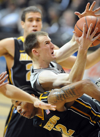 """Levi Knutson of Colorado lands on Marcus Denmon of Missouri. of Missouri.<br /> For more photos of the game, go to  <a href=""""http://www.dailycamera.com"""">http://www.dailycamera.com</a>.<br /> Cliff Grassmick / January 8, 2011"""