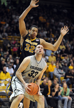 "Austin Dufault of CU goes under Steve Moore of Missouri.<br /> For more photos of the game, go to  <a href=""http://www.dailycamera.com"">http://www.dailycamera.com</a>.<br /> Cliff Grassmick / January 8, 2011"