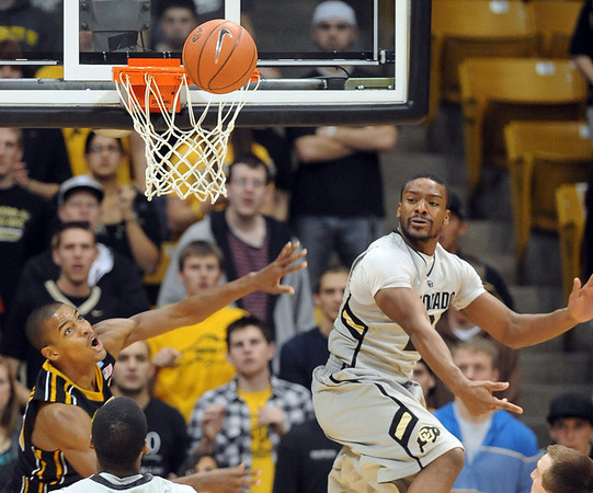 """Shannon Sharpe of CU blocks the shot of Kim English of Missouri.<br /> For more photos of the game, go to  <a href=""""http://www.dailycamera.com"""">http://www.dailycamera.com</a>.<br /> Cliff Grassmick / January 8, 2011"""