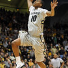 "Alec Burks of CU on a break away dunk against Missouri.<br /> For more photos of the game, go to  <a href=""http://www.dailycamera.com"">http://www.dailycamera.com</a>.<br /> Cliff Grassmick / January 8, 2011"