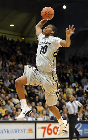"""Alec Burks of CU on a break away dunk against Missouri.<br /> For more photos of the game, go to  <a href=""""http://www.dailycamera.com"""">http://www.dailycamera.com</a>.<br /> Cliff Grassmick / January 8, 2011"""