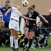 """Hayley Hughes of CU (15) hits the ball past Jessie Crabtree of Missouri.<br /> For more photos of the game, go to  <a href=""""http://www.dailycamera.com"""">http://www.dailycamera.com</a><br /> Cliff Grassmick / October 8, 2010"""
