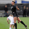 """Amy Barczuk of CU connects with the ball over Krista Kruse of Missouri.<br /> For more photos of the game, go to  <a href=""""http://www.dailycamera.com"""">http://www.dailycamera.com</a><br /> Cliff Grassmick / October 8, 2010"""