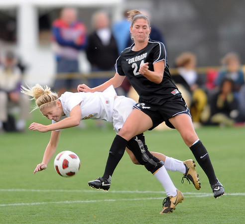 """Maggi Steury (24) of CU knocks over Brittany Hopkins of Missouri.<br /> For more photos of the game, go to  <a href=""""http://www.dailycamera.com"""">http://www.dailycamera.com</a><br /> Cliff Grassmick / October 8, 2010"""