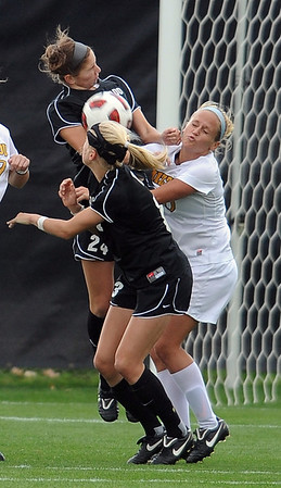 "Maggi Steury, top left, of CU, and Kari Adam of Missouri battle at CU's goal.<br /> For more photos of the game, go to  <a href=""http://www.dailycamera.com"">http://www.dailycamera.com</a><br /> Cliff Grassmick / October 8, 2010"