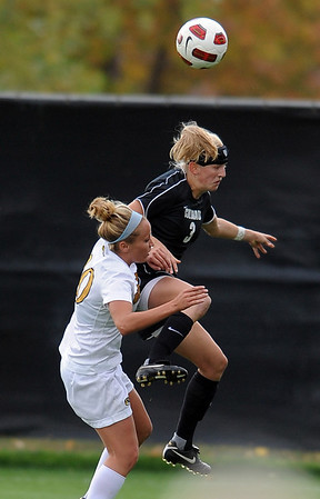 """Alex Dohm of CU connects on the header in front of Jessie Crabtree of Missouri.<br /> For more photos of the game, go to  <a href=""""http://www.dailycamera.com"""">http://www.dailycamera.com</a><br /> Cliff Grassmick / October 8, 2010"""