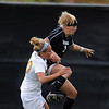 "Alex Dohm of CU connects on the header in front of Jessie Crabtree of Missouri.<br /> For more photos of the game, go to  <a href=""http://www.dailycamera.com"">http://www.dailycamera.com</a><br /> Cliff Grassmick / October 8, 2010"