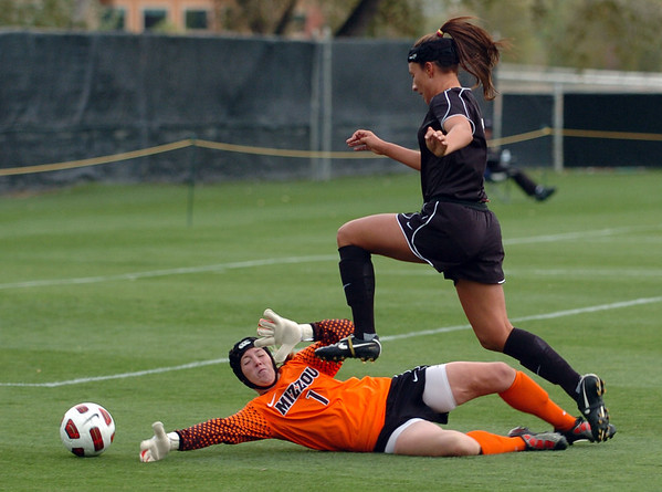 "Kassidy Fitzpatrick of Colorado gets the ball past Missouri keeper, Jessica Gwin, but doesn't score.<br /> For more photos of the game, go to  <a href=""http://www.dailycamera.com"">http://www.dailycamera.com</a><br /> Cliff Grassmick / October 8, 2010"