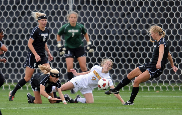 "Kelly Ross, right, of CU, gets the ball out of the goal area in front of Krista Kruse of Missouri.<br /> For more photos of the game, go to  <a href=""http://www.dailycamera.com"">http://www.dailycamera.com</a><br /> Cliff Grassmick / October 8, 2010"