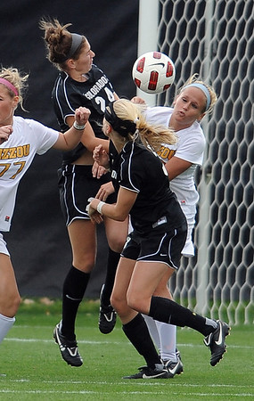 """Maggi Steury, top left, of CU, and Kari Adam of Missouri battle at CU's goal.<br /> For more photos of the game, go to  <a href=""""http://www.dailycamera.com"""">http://www.dailycamera.com</a><br /> Cliff Grassmick / October 8, 2010"""