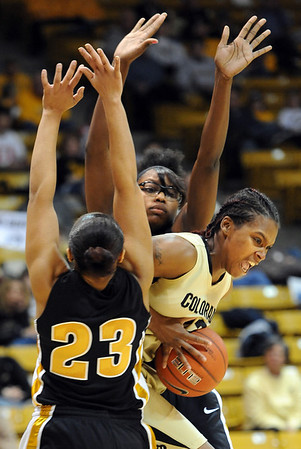 """Brittany Spears of Colorado, muscles through RaeShara Brown (23) and BreAnna Brock of Missouri.<br /> For more photos of the game, go to  <a href=""""http://www.dailycamera.com"""">http://www.dailycamera.com</a>.<br /> Cliff Grassmick / January 22, 2011"""