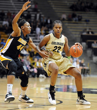 "Brittany Spears of Colorado looks  for room on Shakara Jones of the Tigers.<br /> For more photos of the game, go to  <a href=""http://www.dailycamera.com"">http://www.dailycamera.com</a>.<br /> Cliff Grassmick / January 22, 2011"