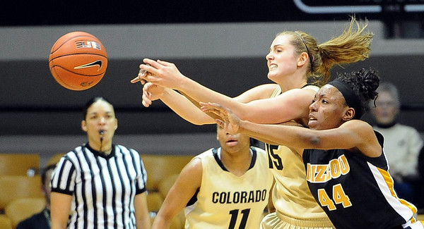 """Julie Seabrook, left, of CU, and Shakara Jones of Missouri, reach for a rebound.<br /> For more photos of the game, go to  <a href=""""http://www.dailycamera.com"""">http://www.dailycamera.com</a>.<br /> Cliff Grassmick / January 22, 2011"""
