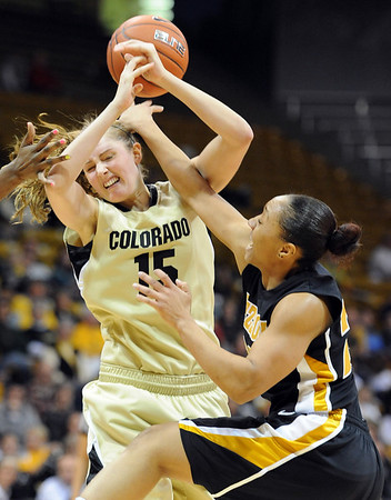 """Julie Seabrook of CU gets hammered by RaeShara Brown of Missouri.<br /> For more photos of the game, go to  <a href=""""http://www.dailycamera.com"""">http://www.dailycamera.com</a>.<br /> Cliff Grassmick / January 22, 2011"""