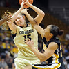 "Julie Seabrook of CU gets hammered by RaeShara Brown of Missouri.<br /> For more photos of the game, go to  <a href=""http://www.dailycamera.com"">http://www.dailycamera.com</a>.<br /> Cliff Grassmick / January 22, 2011"