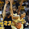 "Brittany Spears of Colorado, muscles through RaeShara Brown (23) and BreAnna Brock of Missouri.<br /> For more photos of the game, go to  <a href=""http://www.dailycamera.com"">http://www.dailycamera.com</a>.<br /> Cliff Grassmick / January 22, 2011"