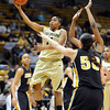 "Brittany Wilson of CU drives through the Missouri defense on Saturday.<br /> For more photos of the game, go to  <a href=""http://www.dailycamera.com"">http://www.dailycamera.com</a>.<br /> Cliff Grassmick / January 22, 2011"